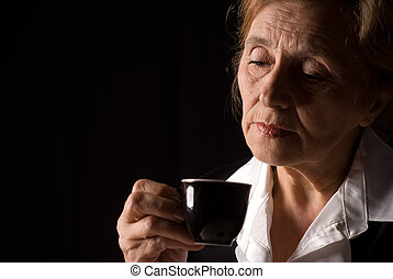 elderly woman drink - portrait of a cute old woman drinking...