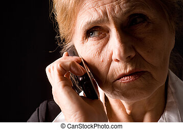 old woman with phone - cute aged woman speaking at the phone...