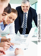 Meeting - Portrait of confident man looking at document...