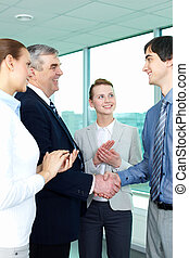 Congrats - Photo of successful businessmen handshaking after...