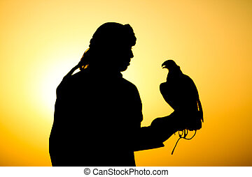 Arabian man silhouette - Arabian man with his falcon...