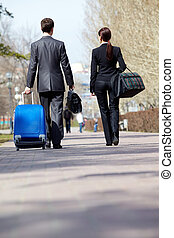 Traveling business partners - Rear view of business partners...
