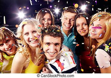 Joyful friends - Portrait of happy glamorous friends in a...