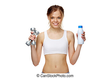 Healthy lifestyle - Portrait of a slim girl holding a bottle...