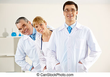 Clinician leader - Portrait of friendly therapists standing...