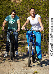 Active weekend - Portrait of a young couple riding bicycles