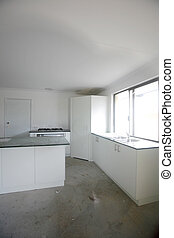 Refurbished kitchen - A modern home kitchen being built with...