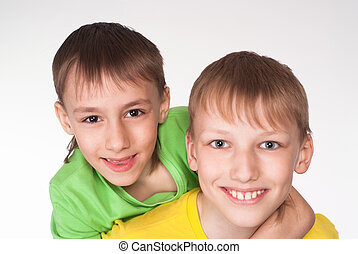 nice brothers playing - portrait of a happy two brothers on...