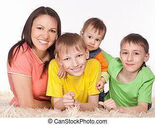 beautiful family lying - portrait of a happy family playing...