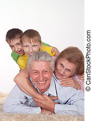 grandparents and grandsons - beautiful family on the carpet
