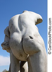 Virile statue - Detailed view of the back of a virile statue...
