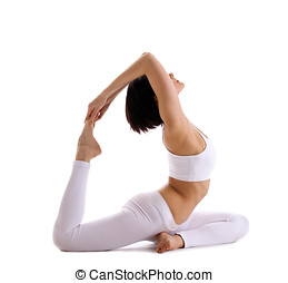Yong woman exercise yoga pose - pigeon isolated - young...
