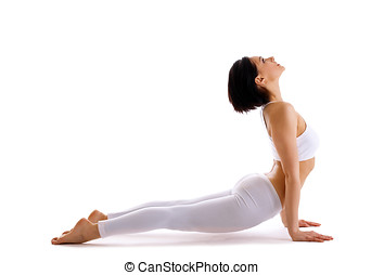 Young woman training yoga - upward facing dog - young woman...