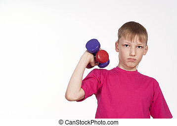 pretty boy keeping fit - young boy keeping fit on a white