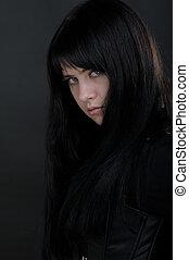 Brunette girl - Portrait of brunette girl on dark background