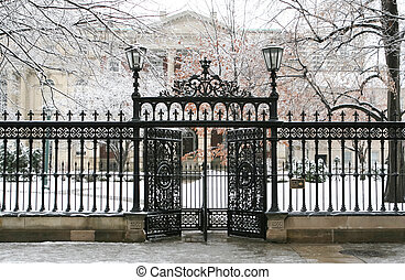 Iron gate - Ornamental gate and fence around Osgood Hall in...