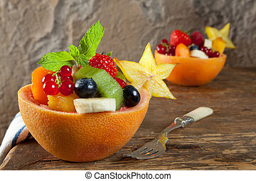 Fruit salad portions - Two portions of fruit salad in...