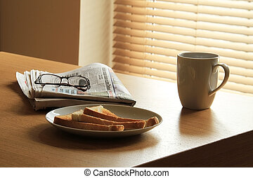 breakfast routine - a breakfast set out on a table lit from...