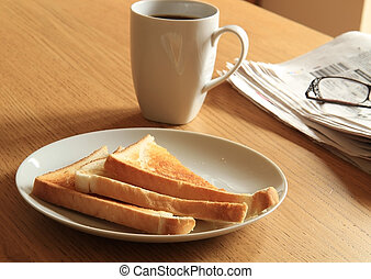 breakfast toast - a breakfast set out on a table lit from...