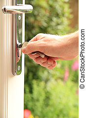 opening door - a man holding onto a set of keys for a new...