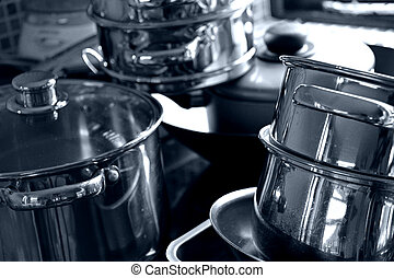 kitchen pans - a shot of kitchen pans all stacked up in a...