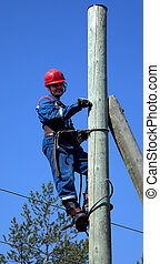 Electrician on a pole makes installation work - Electrician...