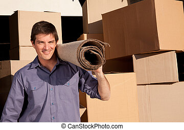 Moving man - A moving an carrying a carpet with cardboard...