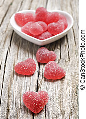 Red heart shaped jelly sweets on wood - Red heart shaped...
