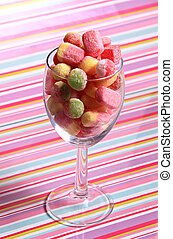 sweets in a jar - a large glass full of multi coloured tasty...