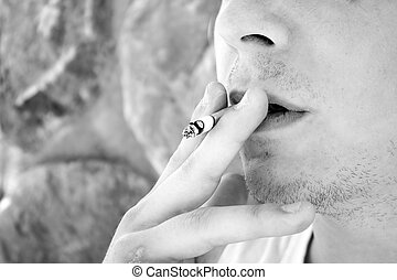 Young Man Smoking a Cigarette - Close up of a young man...