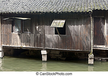 Old shack by a river in China, in the village of wu chen