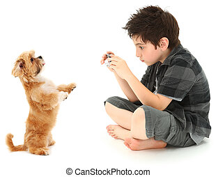 Boy Shooting Photos of His Dog with Digital Camera -...