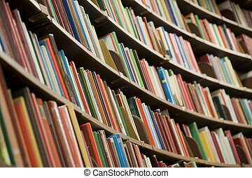 Library - Bookshelf in library with many books. Shallow dof.