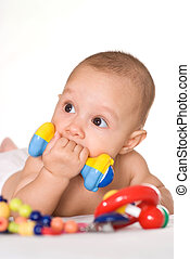 nice baby with toys - small baby playing with toys on bed
