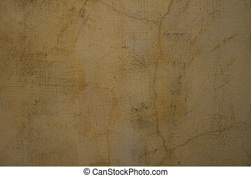 Sandy pale grey cracked plaster wall