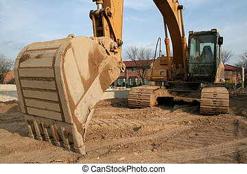 Backhoe Scoop - A wide angle shot of a backhoe at a new...