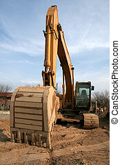 Wide Angle Backhoe - A wide angle shot of a backhoe at a new...