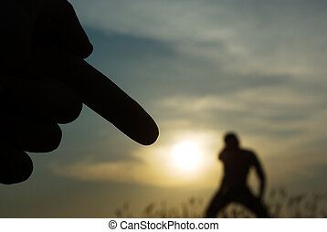 hand, shows a silhouette of a person engaged in sport