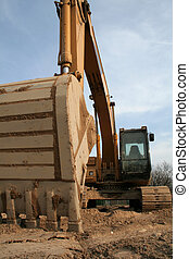 Wide Angle Backhoe from Below - A wide angle shot of a...