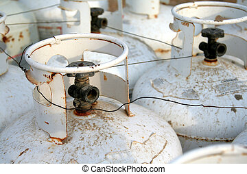 Propane Tanks - The top of a bunch of propane tanks.