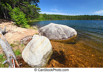 Clear Waters of Northwoods Wisconsin - Huge boulder along...
