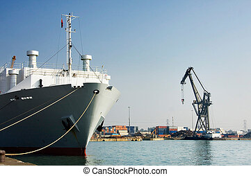 Ship in port, Southampton, UK. Crane and containers on...