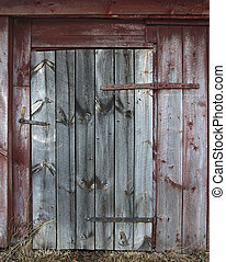 Old wooden door locked with a screw driver
