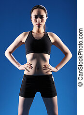 Young beautiful Chinese girl in fitness clothes