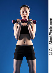 Fit young oriental woman lifting exercise weights -...