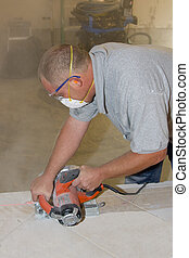 Ceramic Tile Installer - Contractor cutting ceramic tile to...