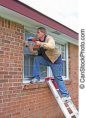 Home Repairs - Carpenter installing new storm windows, home...