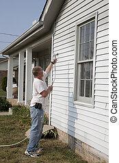 Spray Painting - Painter spray painting house, repairs of...