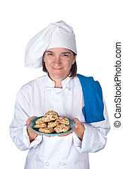 Chef holding plate of cookies