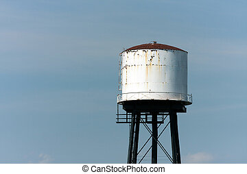 Old Rusting Water Tower - An old rusted water tower isolated...